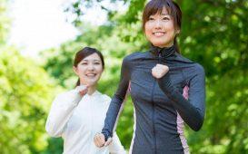 two-asian-woman-running